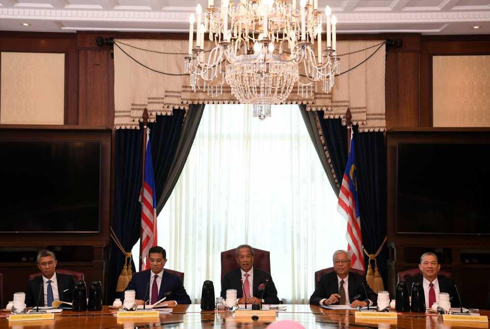 Prime Minister Tan Sri Muhyiddin Yassin chairs the first new Cabinet meeting at the Perdana Putra in Putrajaya March 11, 2020. — Bernama pic
