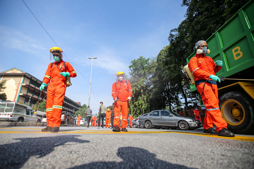 DBKL and Alam Flora personnel sanitise the area around the Sri Petaling Mosque March 28, 2020. ― Picture by Hari Anggara