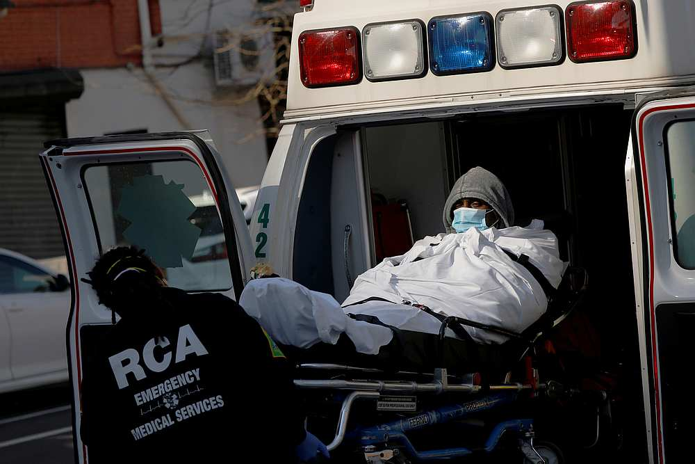 A patient is put into an ambulance as health workers continue to test people for Covid-19 outside the Brooklyn Hospital Center in New York March 27, 2020. — Reuters pic