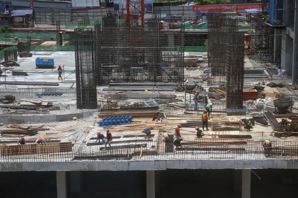 Workers are pictured at the construction site of Pavilion Damansara Heights March 18, 2020. — Picture by Choo Choy May