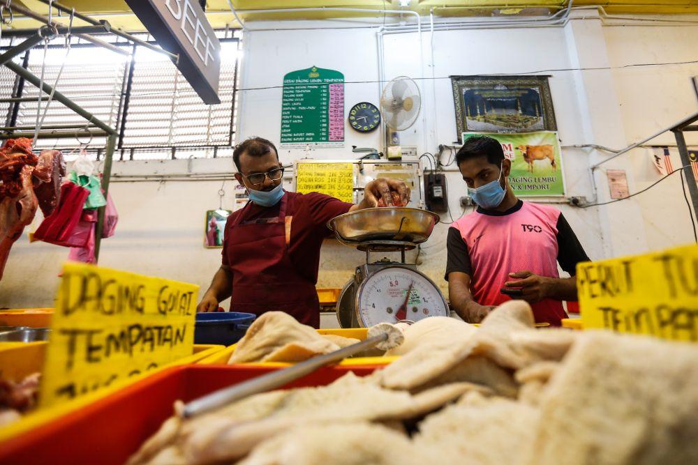 Butcher Abdul Rahman Kachi Mydin prepares the day's orders at the Taman Tun Sardon Wet Market in Penang March 26, 2020. — Sayuti Zainudin