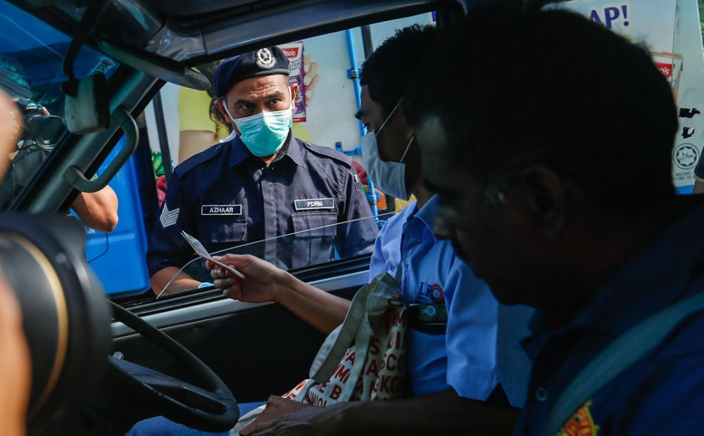 Police personnel inspect a vehicle at a roadblock on Jalan Tun Dr Awang in Penang March 19, 2020. — Picture by Sayuti Zainudin
