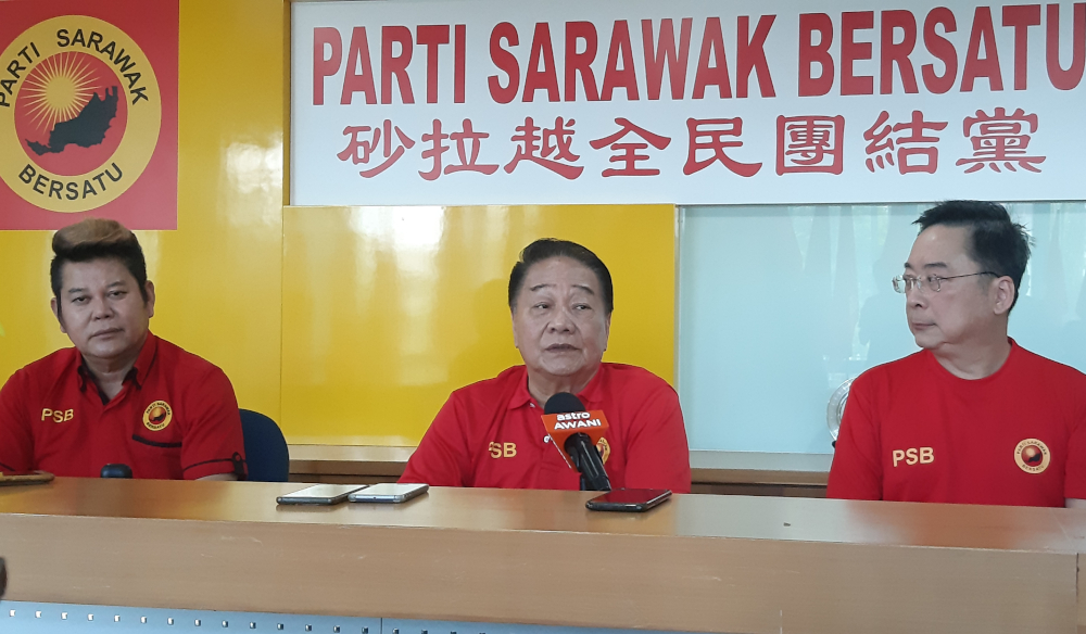 PSB president Datuk Seri Wong Soon Koh (centre) speaks to reporters in Kuching March 14, 2020. — Picture by Sulok Tawie