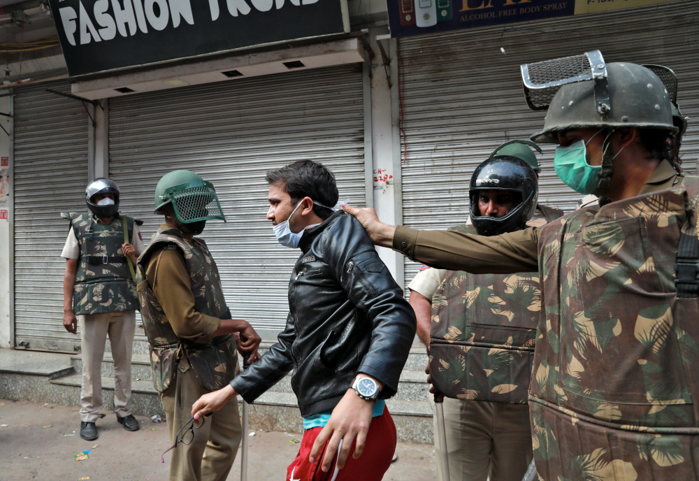 Police detain a youth as he argues with them after they cleared the site of the longest-running protest against a new citizenship law following the lockdown to limit the spreading of coronavirus disease (Covid-19), in New Delhi March 24, 2020. — Reuters