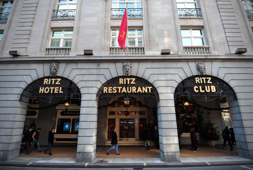In this file photo taken December 17, 2012 people walk past the Ritz hotel in central London. The London Ritz, a famous luxury hotel, was sold to an investor in Qatar by the wealthy Barclay brothers who are tearing themselves apart around this sale, for close to £800 million. — AFP pic