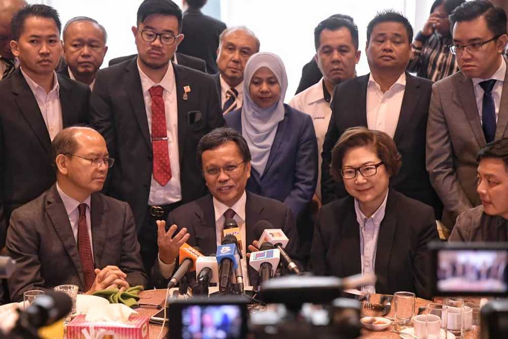 Sabah Chief Minister Datuk Seri Shafie Apdal (centre) said that the state government would work with Putrajaya in the interests of the people but that it would not be politically affiliated. ― Picture by Julia Chan