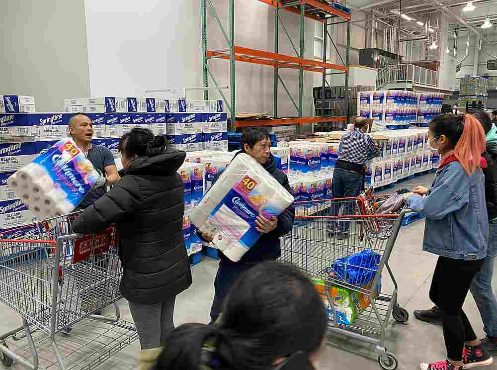 Workers ration toilet paper to one package per Costco member in an effort to stem hoarding due to fears of coronavirus, at a Costco store in Toronto, Ontario, Canada March 14, 2020. — Reuters pic