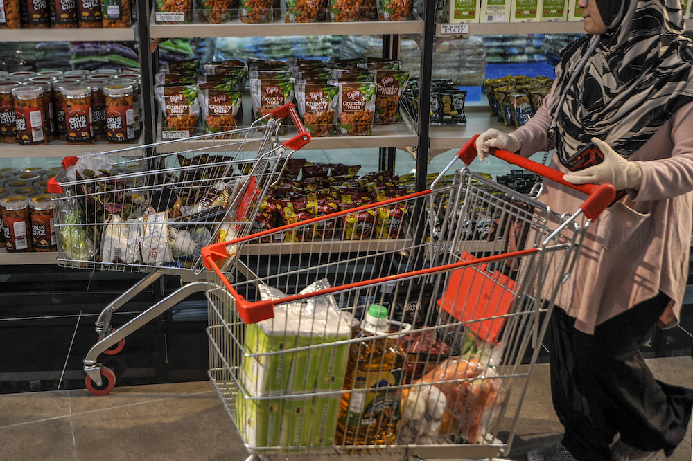 A customer buying a groceries at a supermarket in Cyberjaya April 5, 2020. — Picture by Shafwan Zaidon