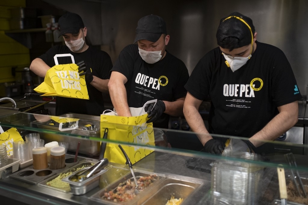 Workers of a delivery restaurant prepare meals to be delivered by Delivery4Heroes to the healthcare personnel dealing with the novel coronavirus in Barcelona April 4, 2020. — AFP pic