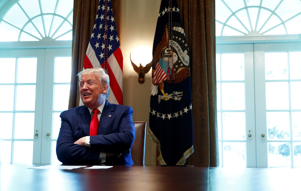 US President Donald Trump laughs during a roundtable meeting with energy sector CEOs in the Cabinet Room of the White House in Washington April 3, 2020. — Reuters pic