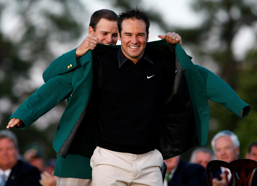 Trevor Immelman (right) of South Africa receives the green jacket from former champion Zach Johnson (left) after Immelman won the 2008 Masters golf tournament at the Augusta National Golf Club in Augusta, Georgia April 13, 2008. — Reuters pic