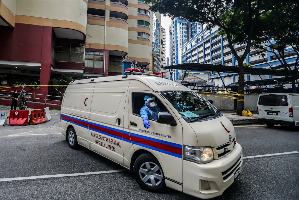 File picture of an ambulance leaving Menara City One during the enhanced movement control order (EMCO) in Kuala Lumpur April 5, 2020. — Picture by Firdaus Latif