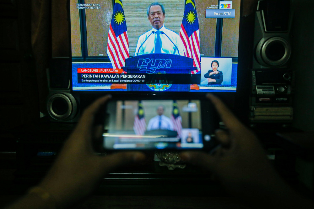 Prime Minister Tan Sri Muhyiddin Yassin today announced today a slight relaxation for those stuck elsewhere to return home during the movement control order. — Picture by Hari Anggara