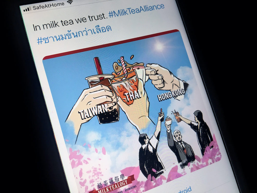 A mobile phone displays an internet meme of a growing online movement called 'Milk Tea Alliance' to show solidarity between Thailand, Taiwan and Hong Kong, in this illustration taken on April 15, 2020. — Reuters pic