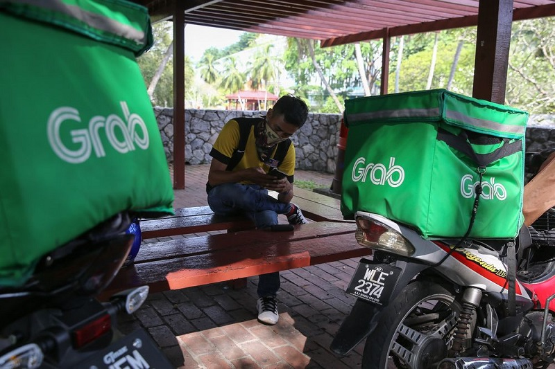 Grab's services will continue operating as usual during the re-implementation of the restricted movement order period. — Picture by Yusof Mat Isa