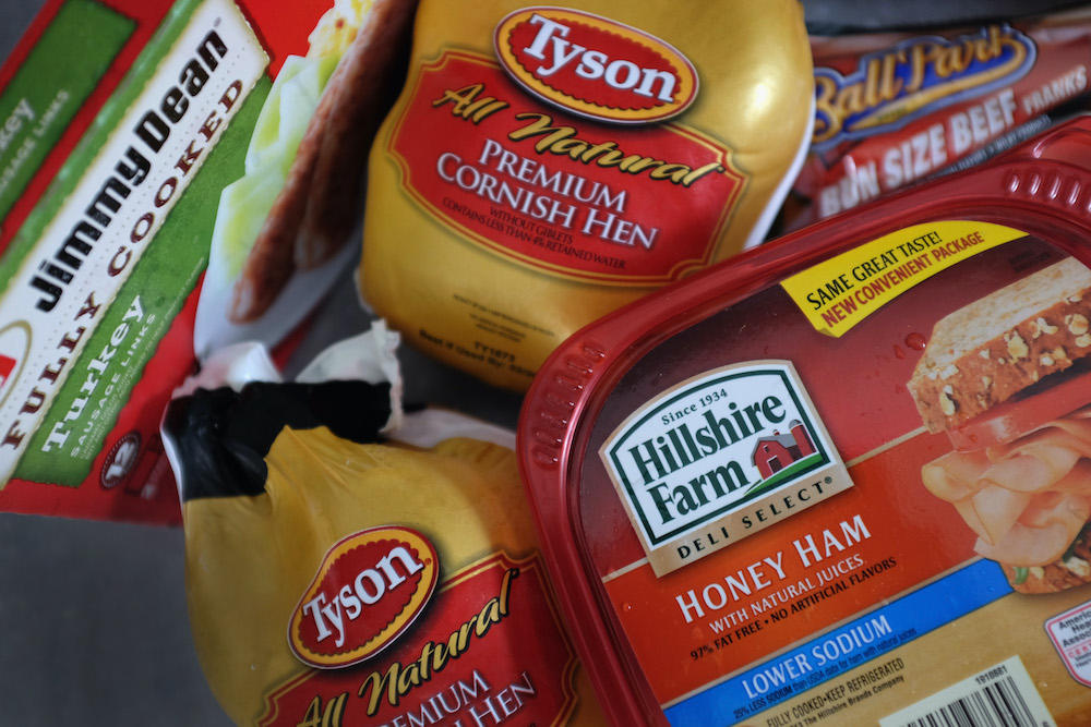In this file photo taken on May 29, 2014 Tyson Food and Hillshire Brands food products are seen in Miami, Florida. — AFP pic