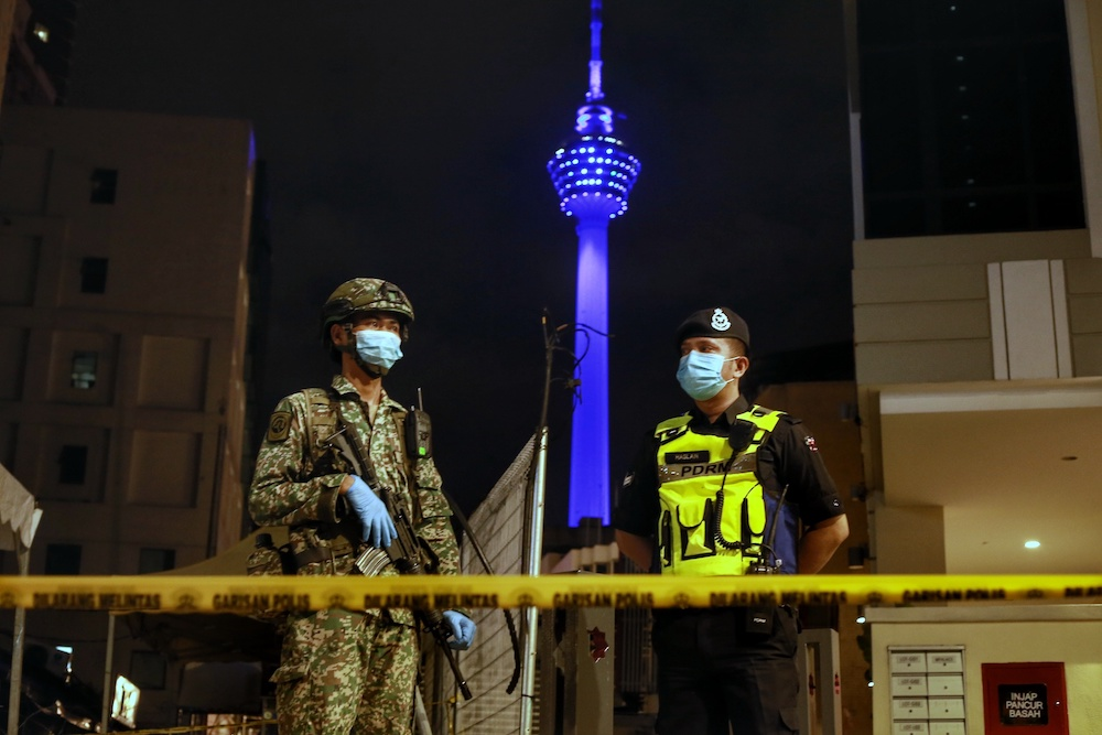 The KL Tower is illuminated in blue in a show of solidarity for frontliners battling the Covid-19 outbreak April 30, 2020. KL Tower reopened on July 1. — Picture by Ahmad Zamzahuri