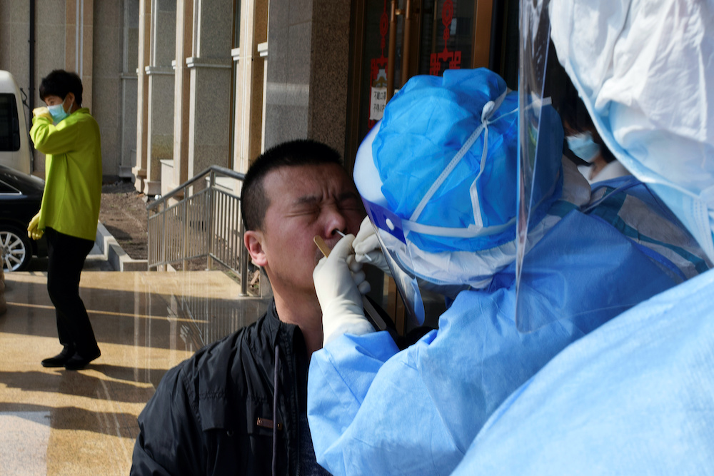 A worker from the city's centre for disease control and prevention takes a swab from a man to test for the coronavirus disease (Covid-19) in Suifenhe, a city bordering Russia in China's Heilongjiang province, April 16, 2020. ― Reuters pic
