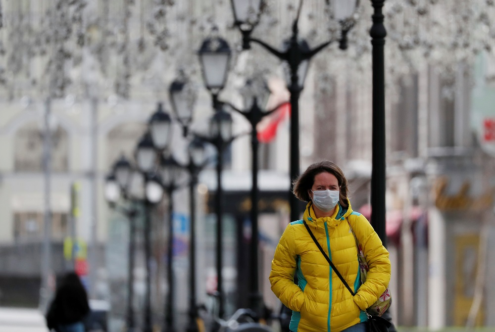 A woman wearing a protective face mask walks along the street, as the spread of the coronavirus disease continues, in Moscow April 10, 2020. ― Reuters pic