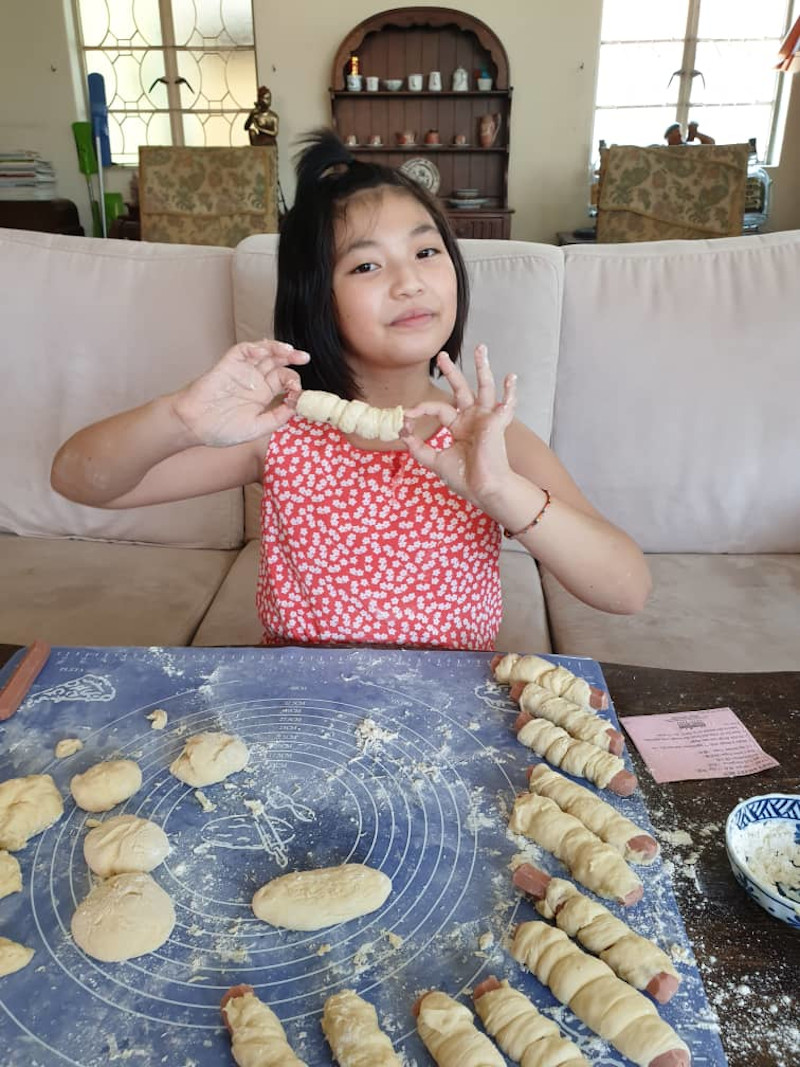 Ooi demonstrates how to make sausage buns at home. — Picture courtesy of Christina Cheng