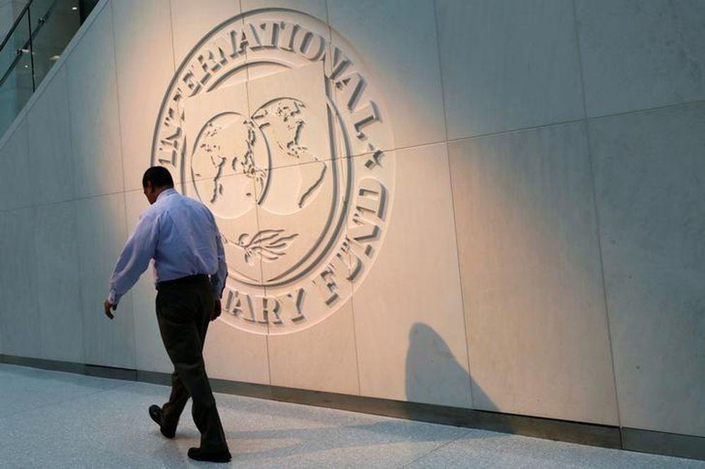 A man walks past the International Monetary Fund (IMF) logo at its headquarters in Washington, US, May 10, 2018. — Reuters pic