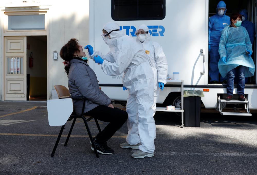 Italy has registered 127,101 deaths linked to Covid-19 since its outbreak emerged in February last year. — Reuters pic