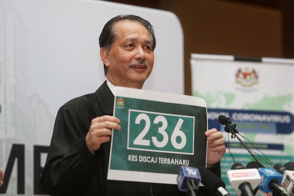 Health director-general Datuk Dr Noor Hisham Abdullah holding a poster showing the 236 patients who have been discharged April 6, 2020. — Picture by Choo Choy May