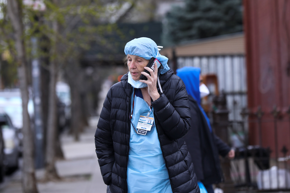 A nurse makes a phone call during a break outside the Wyckoff Heights Medical Center during the outbreak of the coronavirus disease (Covid-19) in the Brooklyn borough of New York City, New York, US, April 10, 2020. ― Reuters pic