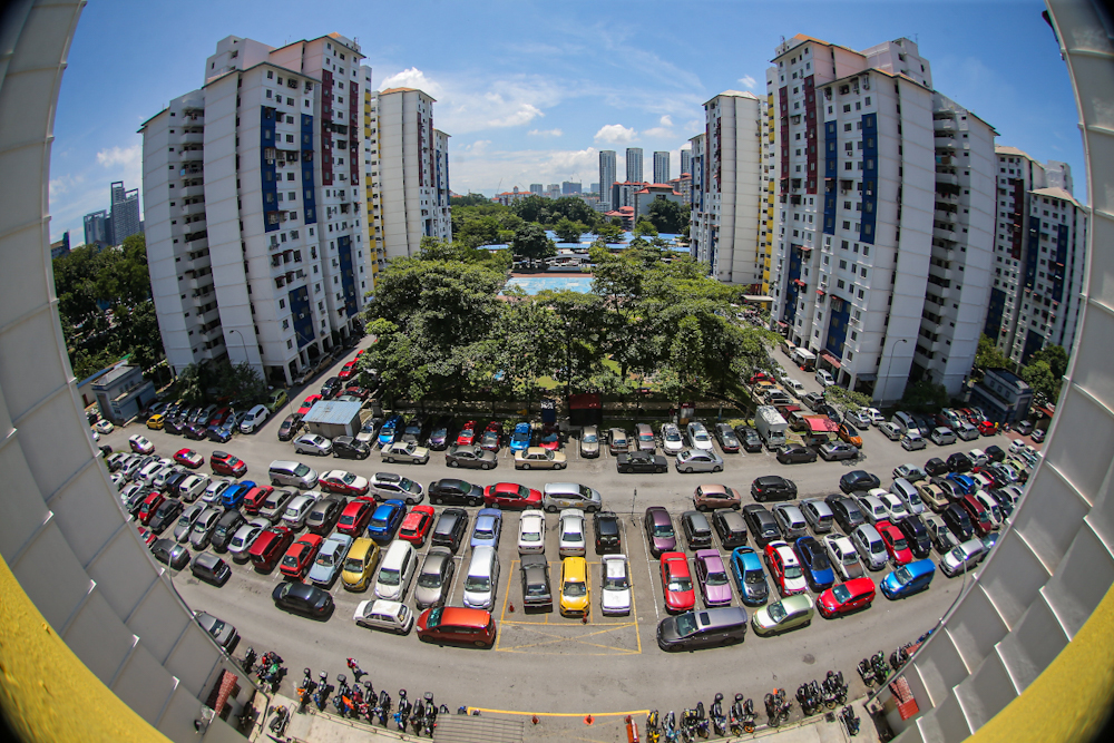 A view of cars in the parking lot at PPR Kerinchi. — Picture by Hari Anggara