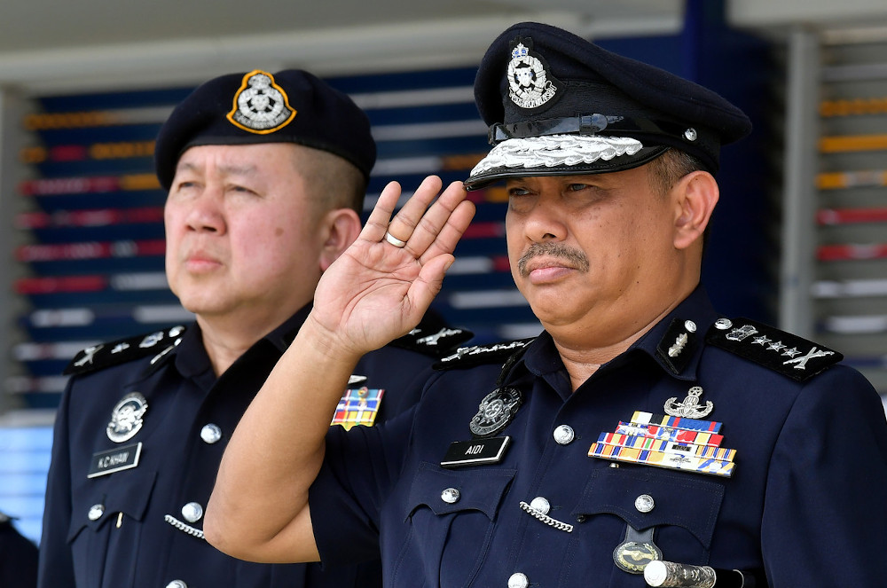 Sarawak Police Commissioner Datuk Aidi Ismail salutes officers and General Operations Force personnel at the Sarawak Brigade headquarters in Kuching March 2, 2020. — Bernama pic