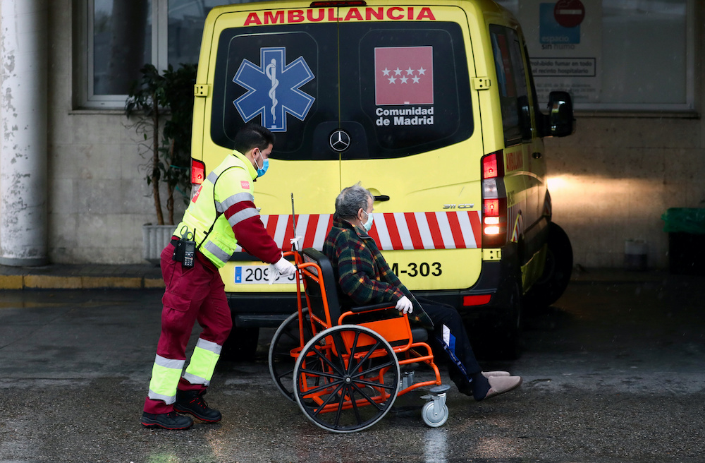 An ambulance worker arrives with a patient at the 12 de Octubre Hospital, amid the coronavirus disease (Covid-19) outbreak, in Madrid, Spain March 31, 2020. — Reuters pic