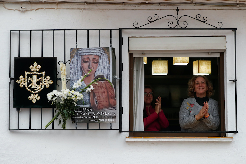 People applaud in support of healthcare workers as they celebrate the Holy Week amid the coronavirus disease (Covid-19) outbreak, in Ronda, southern Spain, April 8, 2020. — Reuters pic