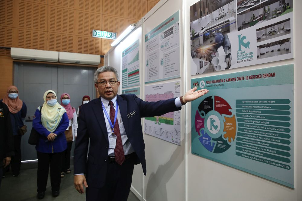 Health Minister Datuk Seri Dr Adham Baba speaks to reporters at the low-risk Covid-19 quarantine and treatment centre at the Malaysia Agro Exposition Park Serdang April 3, 2020.  — Picture by Yusof Mat Isa