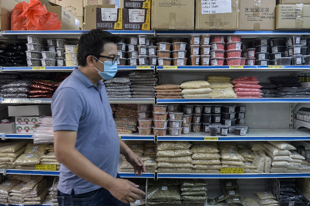 A customer shops for baking supplies at a bakery supply shop during movement control order (MCO) in Shah Alam April 22, 2020. — Picture by Miera Zulyana