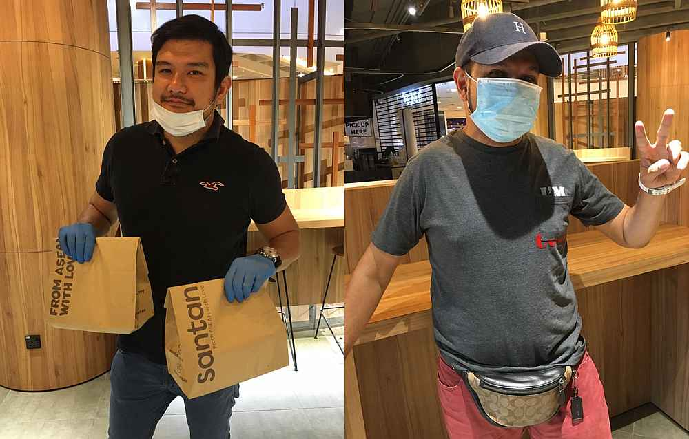 Benyamin Ismail (left) says he would gladly do food delivery again to show support to his fellow AirAsia X colleagues like Felix Junior Theseira (right). — Picture courtesy of AirAsia