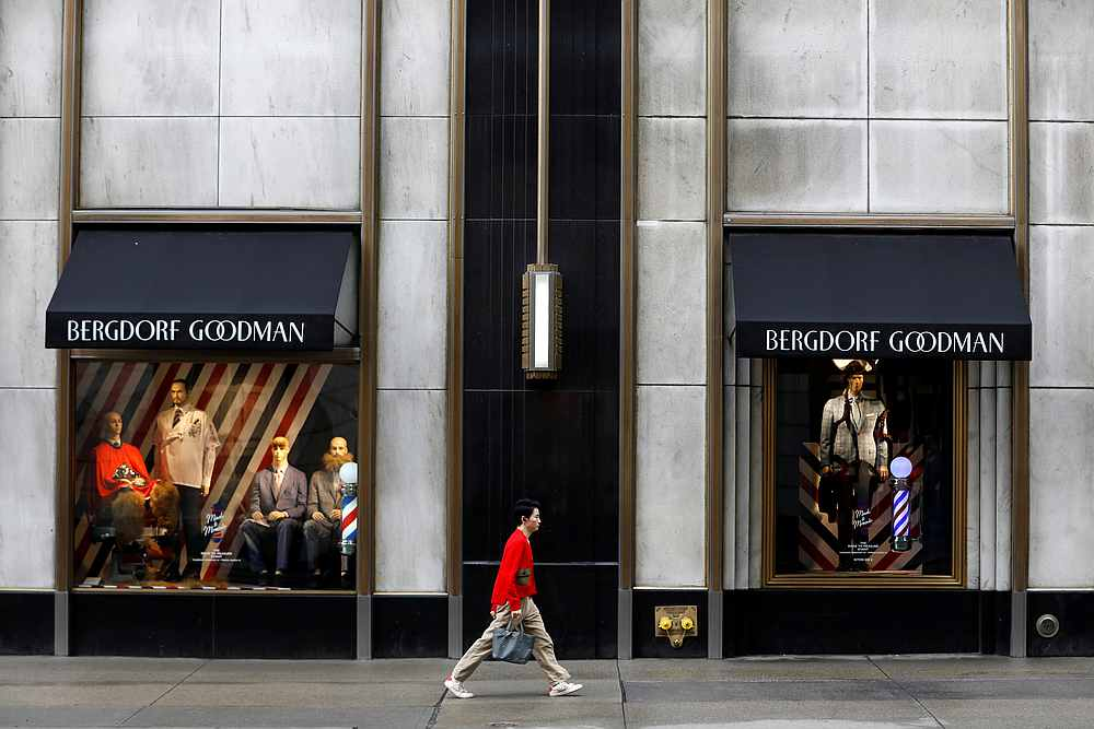 A person walks by Bergdorf Goodman on Fifth Avenue as retailers reported a downturn in sales related to the Covid-19 outbreak in New York March 13, 2020.  — Reuters pic