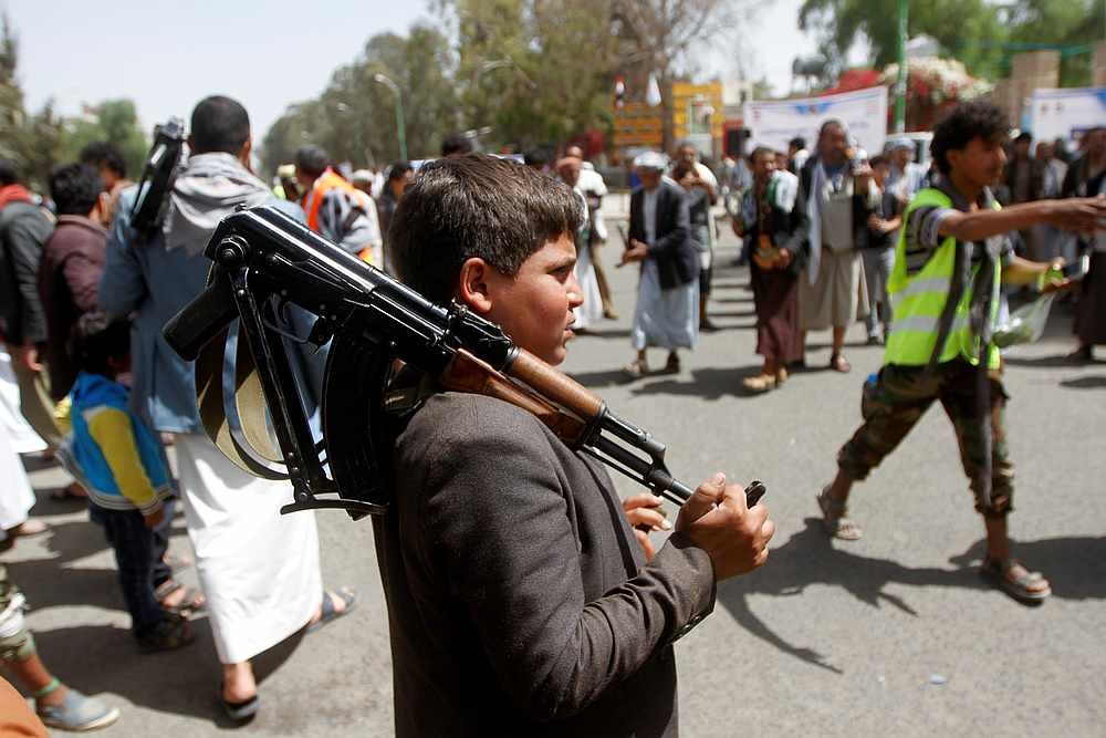 A boy carries a weapon as he and Houthi supporters are seen during a gathering in Sanaa, Yemen April 2, 2020. — Reuters pic