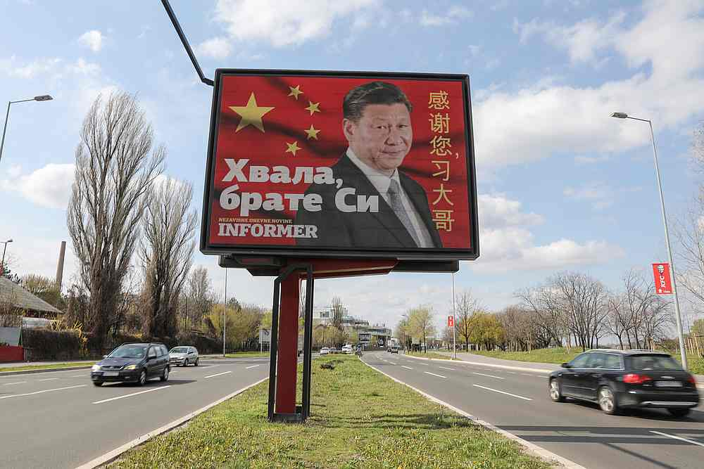 Cars drive by a billboard depicting Chinese President Xi Jinping in Belgrade, Serbia, April 1, 2020. The text on the billboard reads 'Thanks, brother Xi.' — Reuters pic