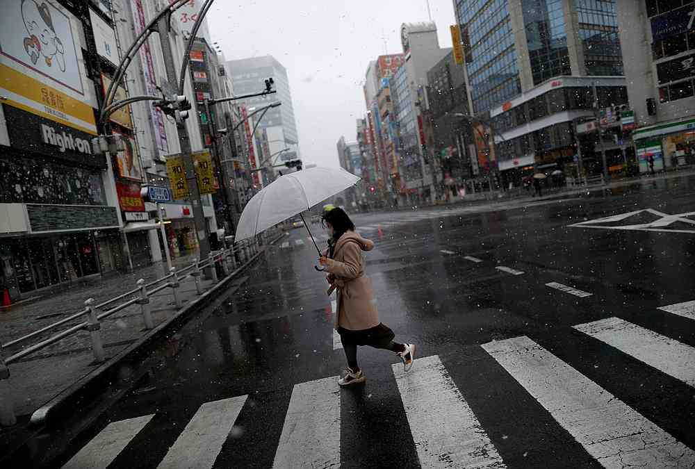 A Japanese woman out shopping in Tokyo, Japan March 29, 2020. — Reuters file pic
