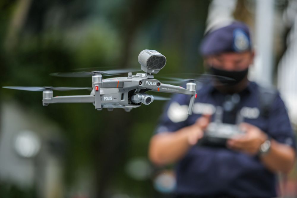 Police use a drone to monitor enhanced movement control order imposed on Menara City One, Kuala Lumpur April 15, 2020. ― Picture by Hari Anggara