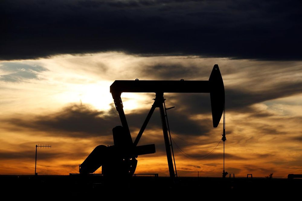 The sun sets behind a crude oil pump jack on a drill pad in the Permian Basin in Loving County, Texas, US, November 24, 2019. — Reuters pic