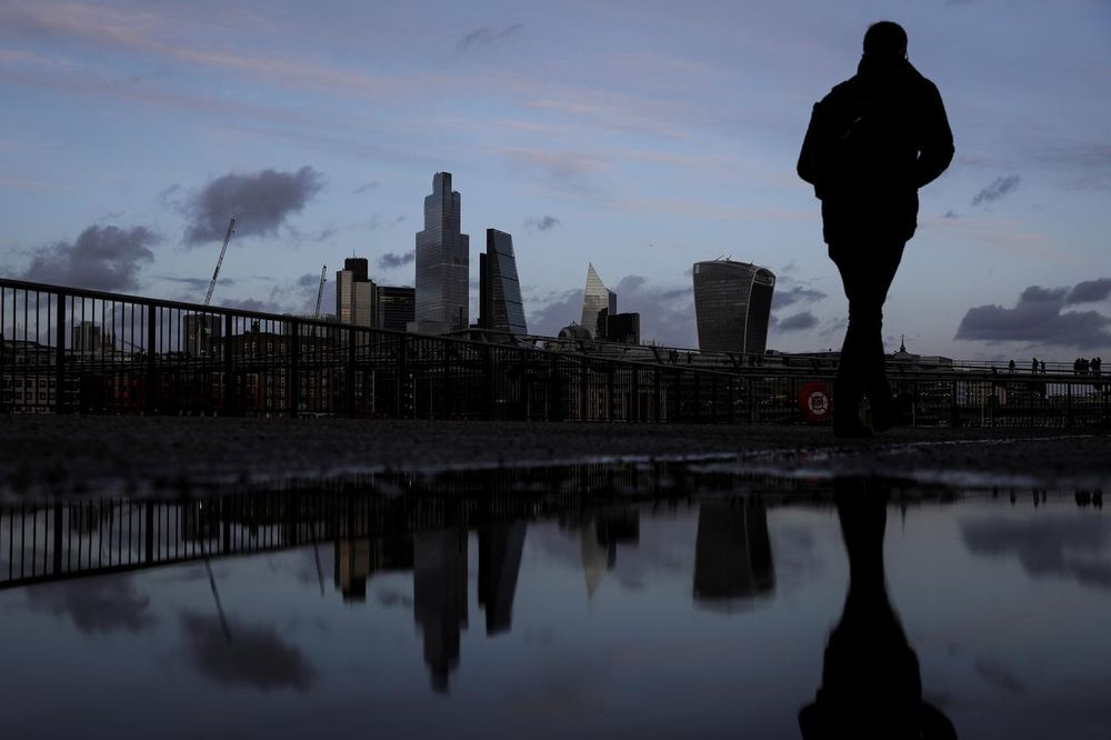 Pedestrians walk along the Southbank in view of skyscrapers in the financial district in London, February 17, 2020. — Reuters pic