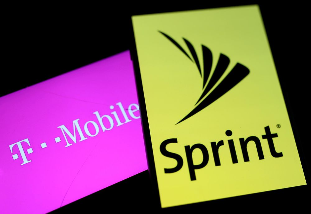 Smartphones with the logos of T-Mobile and Sprint are seen in this illustration taken September 19, 2017. — Reuters pic