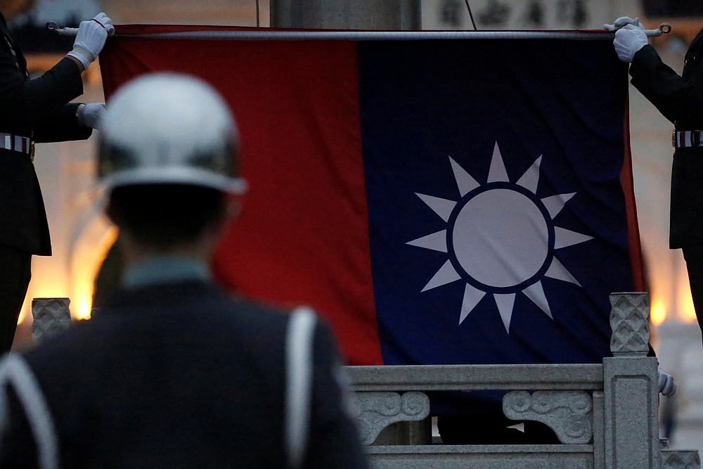 File photo of Honour guards perform Taiwan national flag lowering ceremony at Liberty Square, as the spread of the Covid-19 continues, in Taipei, Taiwan, April 1, 2020. — Reuters pic