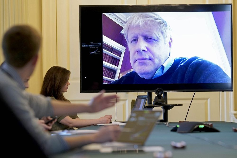 A handout picture released on March 28, 2020, shows an image of Britain's Prime Minister Boris Johnson on a screen as he remotely chairs the morning novel coronavirus meeting by video link, in Downing Street in London. — 10 Downing Street / AFP pic