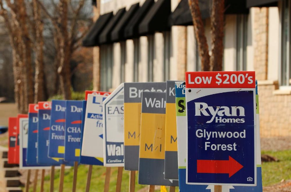 Real estate signs advertise new homes for sale in multiple new developments in York County, South Carolina, US, February 29, 2020. — Reuters pic