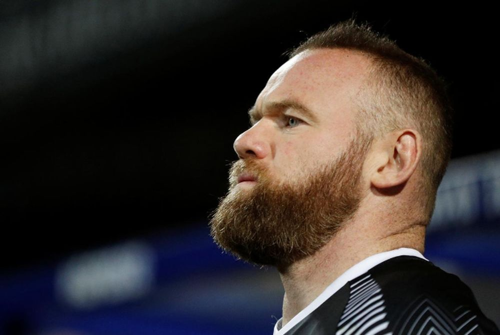 Reports say Derby captain Wayne Rooney is leading talks on behalf of his teammates against a proposal by the club to defer wages of players by 50 per cent and the striker's spokesperson had said he was not in a 'wage war'. — Action Images via Reuters