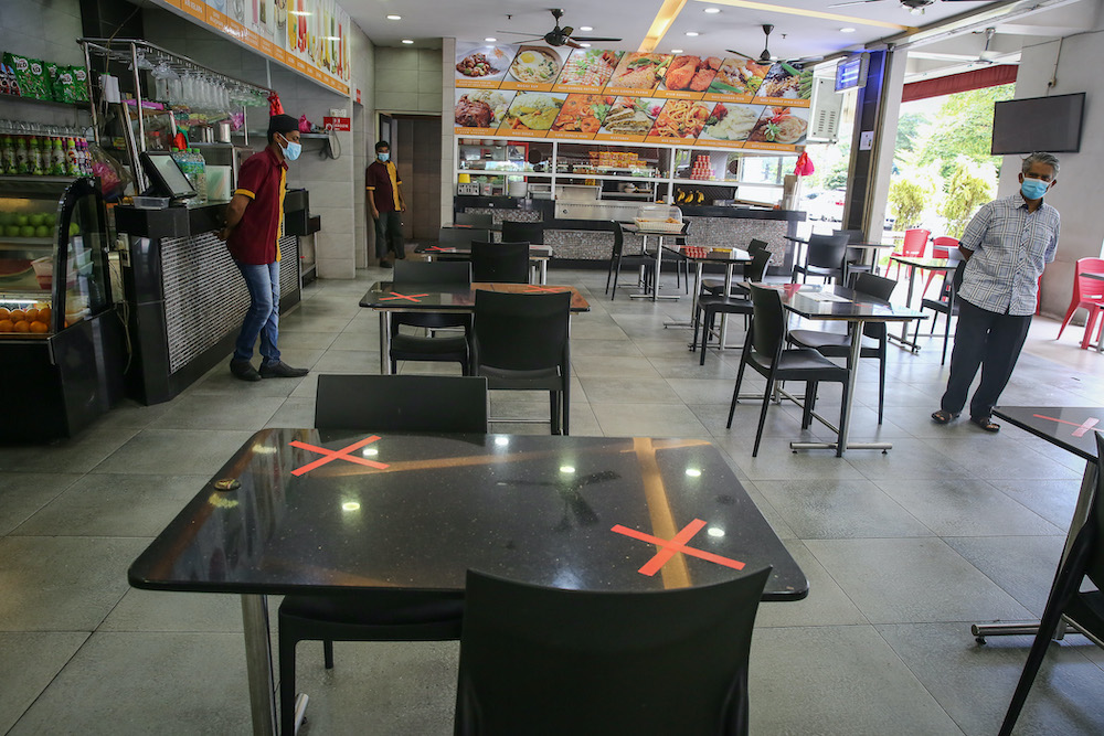 Restaurant owners feel it is best to continue with takeaways as they are better able to adopt strict social distancing requirements. — Picture by Yusof Mat Isa