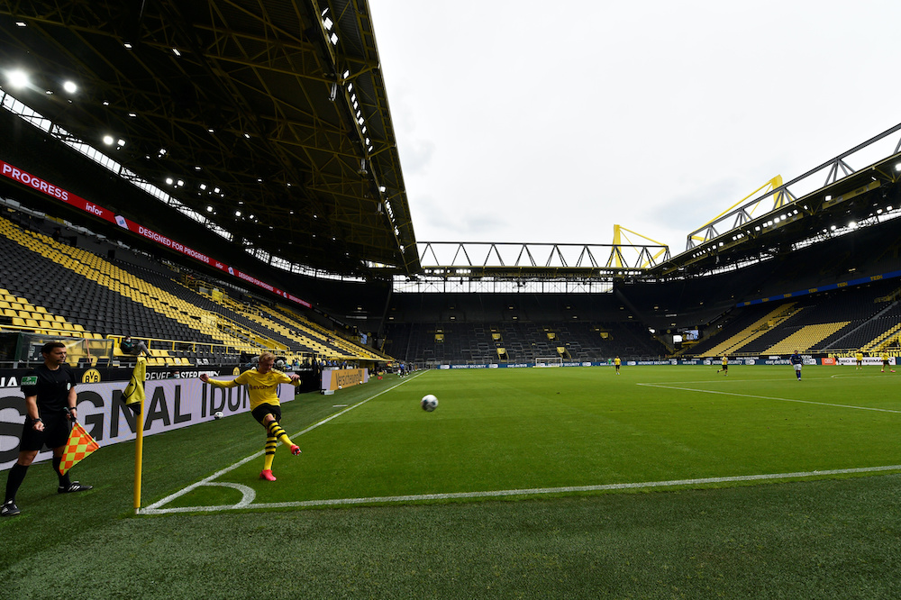 Dortmund's Erling Haaland kicks the ball, as play resumes behind closed doors following the outbreak of the coronavirus disease (Covid-19) in Signal Iduna Park, Dortmund May 16, 2020. Martin Meissner/Pool via Reuters