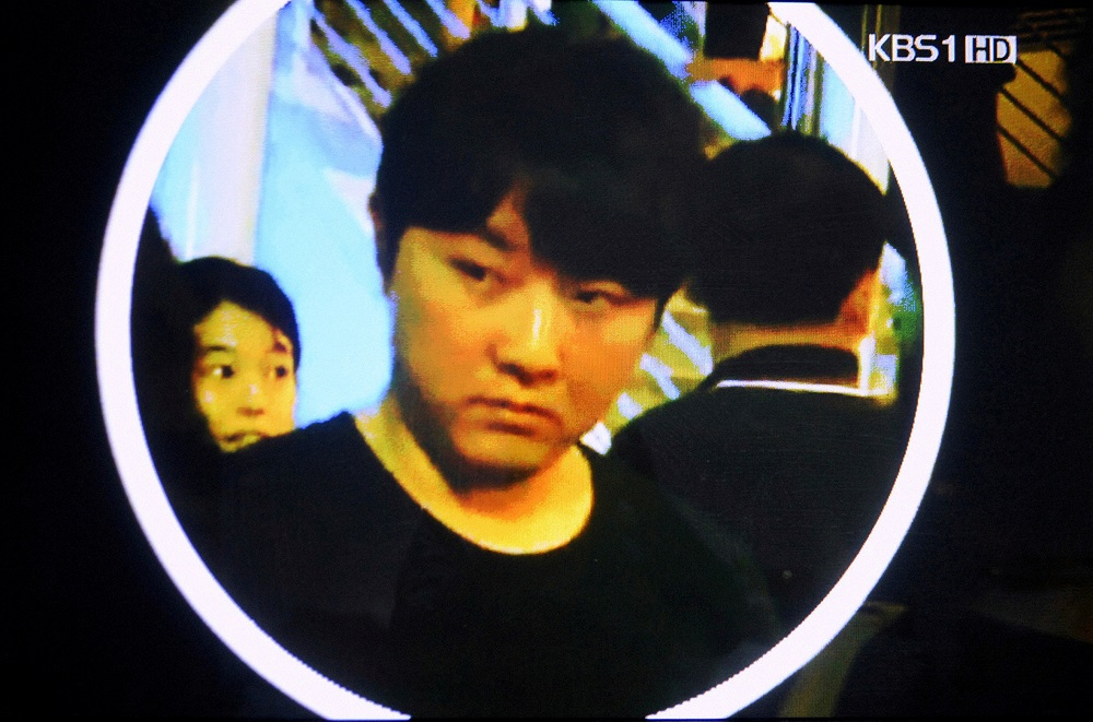 A still image taken from a Korean Broadcasting System video and provided by the Kyodo news agency, shows a man reported by the network to be Kim Jong-chol at an Eric Clapton concert in Singapore February 14, 2011. — Picture courtesy of Japan Out via Reuters